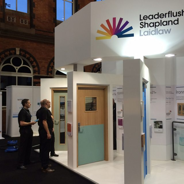 A robust corporate stand showing doors in action. & Leaderflush Shapland Laidlaw - Show Off Display